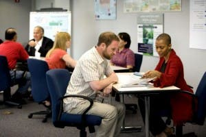 six-people-working-in-office-725x483
