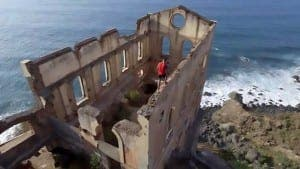 "Pic shows: Rubén Alonso Bizarro climbing the top of a ruined building; These are the terrifying images captured by a drone showing a man walking atop the dangerously high walls of a seaside ruin. The dramatic images were captured in the town of Los Realejos on the Spanish island of Tenerife. The video, later shared on YouTube, shows adventure sports enthusiast Ruben Alonso Bizarro walking along the narrow graffiti covered walls of a decrepit building called La Gordejuela. The drone takes in the dramatic scenery around the building, showing the blue sea, black pebbly beach and mountains surrounding the tall ruined building. Bizarro, from the Spanish region of Asturias, walks along until the tallest point of the building at the front where he puts his arms out as if flying. Bizzaro is a lover of ""sports and the good life"" according to his Instagram page where he uploads many pictures of himself on thrilling adventure holidays amidst the amazing scenery of the volcanic island. . He has a following of more than 3,500, who comment admiringly on his post One user wrote: ""Wow congratulations on the video, amazing."" Whilst another commented: ""The more I see it the more vertigo I get!"";"
