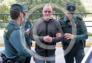 CUFFED: Simon Corner hauled into court. PHOTO: Copyright The Olive Press