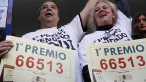 WINNERS: Madrid residents celebrate El Gordo prize