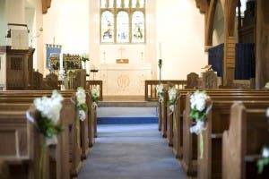 looking down a church aisle towards the altar