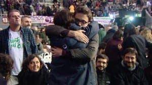 Pablo Iglesias and Inigo Errejon hug after the Podemos votes