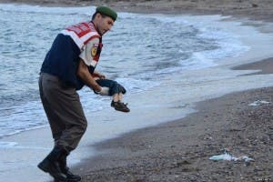 HARROWING: Alan Kurdi being removed from beach