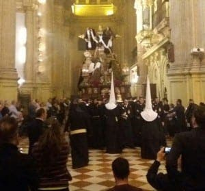 SACRED: Nazarenos and spectators congregate in church