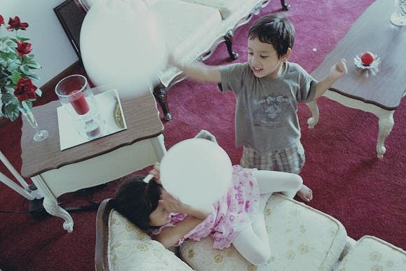 Siblings Pillow Fight