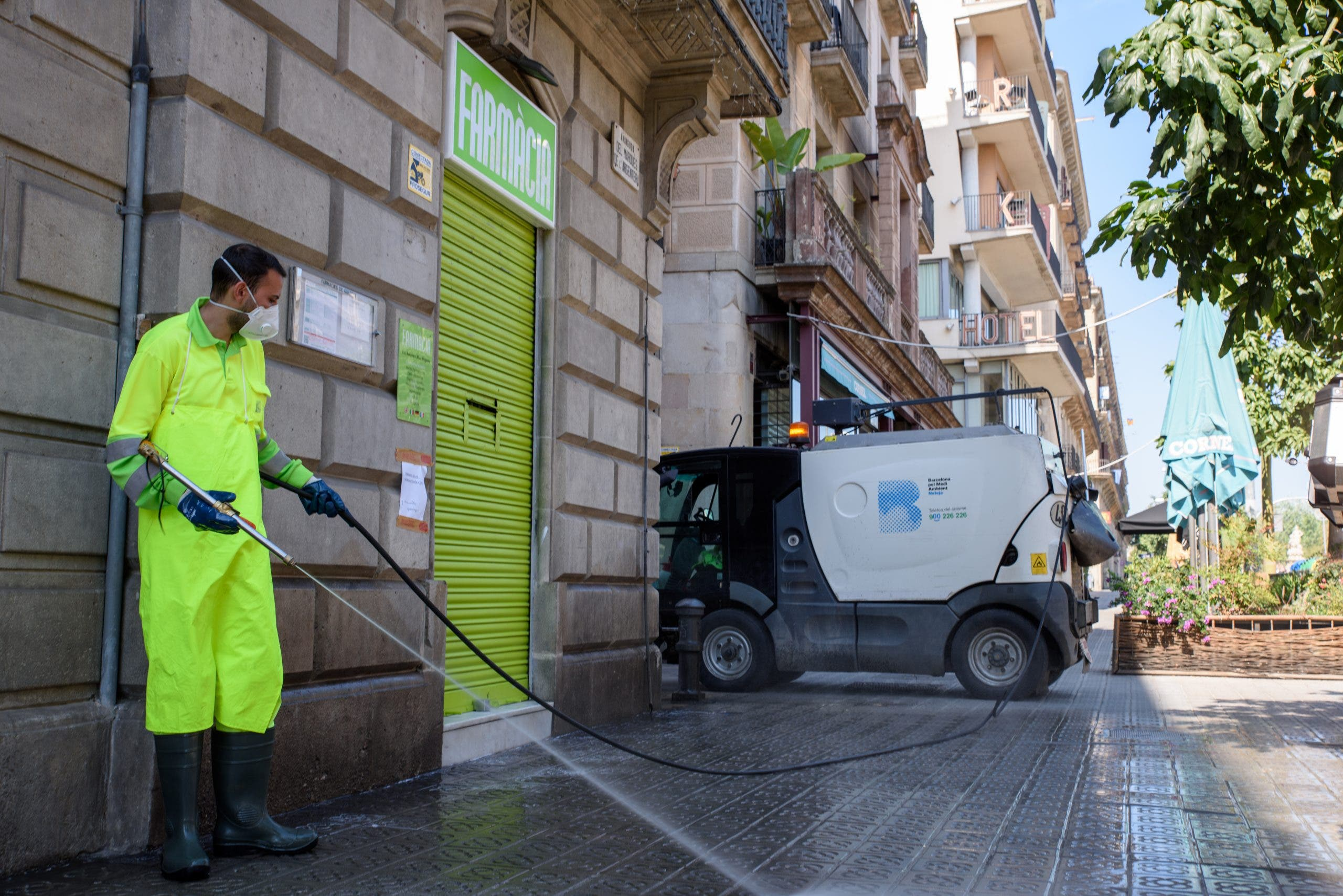 Barcelona Street Cleaning Team Disinfects Area Around Pharmacy 7