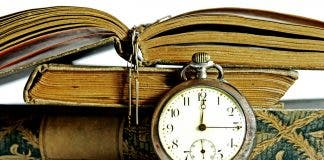An Old Pocket Watch And Antique Books