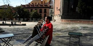 A Waitress Carries Chairs After The Town Hall Decreed The Closure Of The Terraces In Madrid