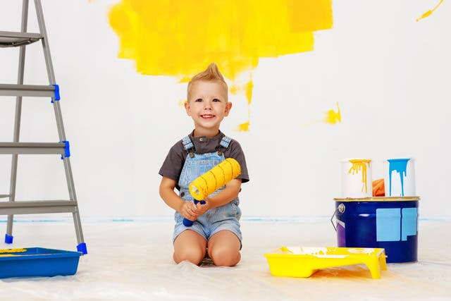 Repair In Apartment Happy Child Boy Paints Wall