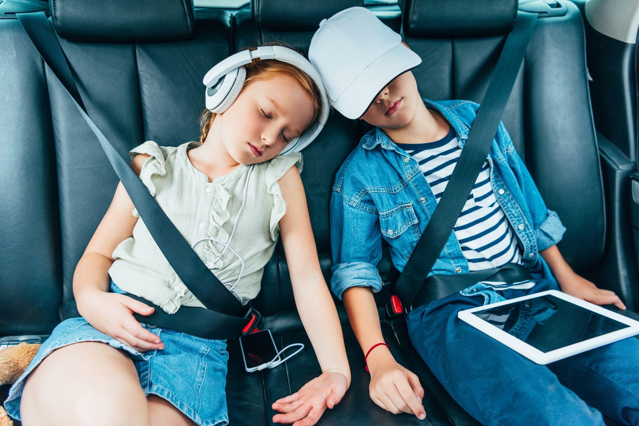 Kids Sleeping On Backseats Of Car