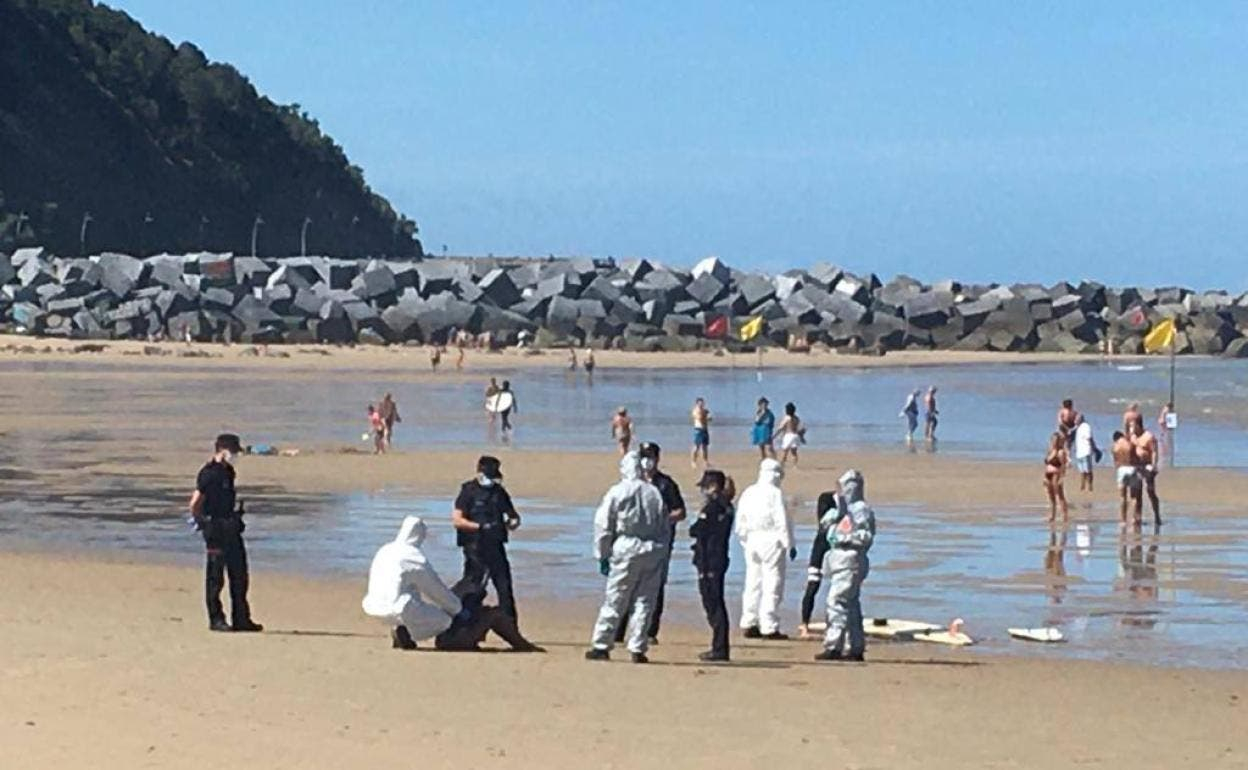 Surfer dragged off beach in Spain by men in hazmat suits after testing  positive for COVID-19 and refusing to quarantine - Olive Press News Spain