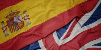 Waving Colorful Flag Of Great Britain And National Flag Of Spain