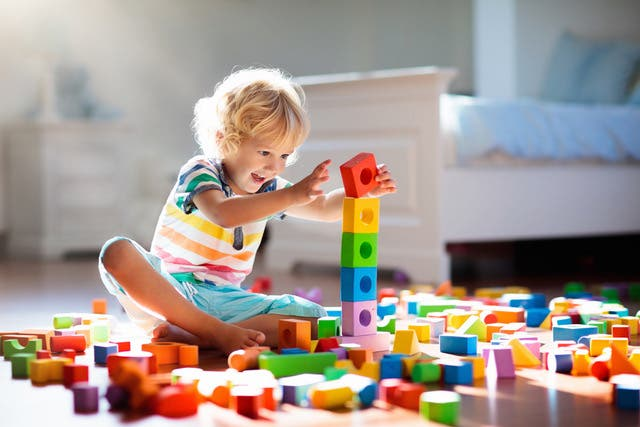 Child Playing With Colorful Toy Blocks Kids Play