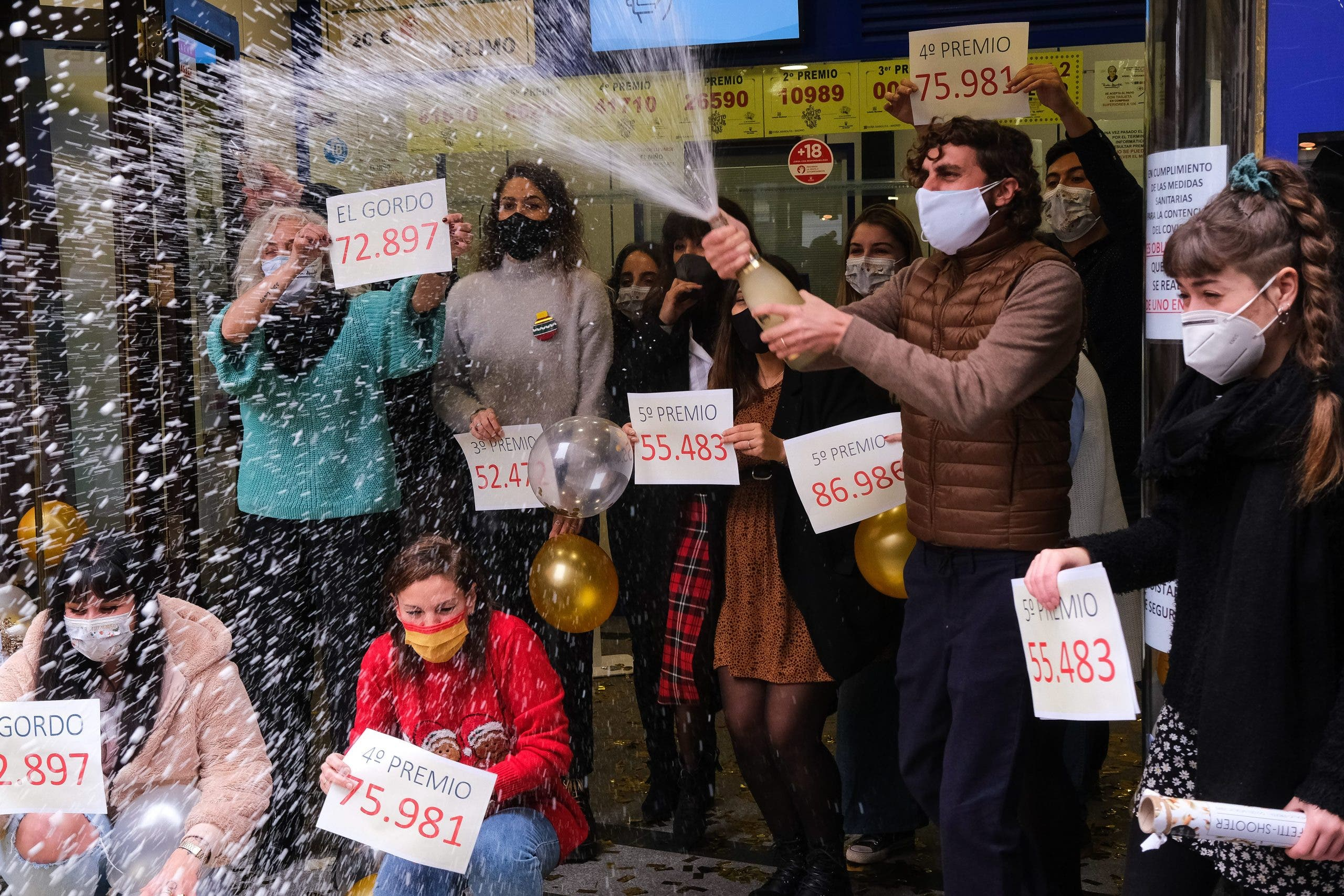 Lottery sellers show the winning numbers on Tuesday