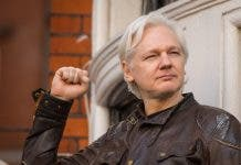 Julian Assange outside the Ecuadorian embassy in London