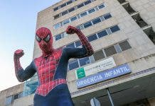 Spiderman outside Malaga maternity hospital in December
