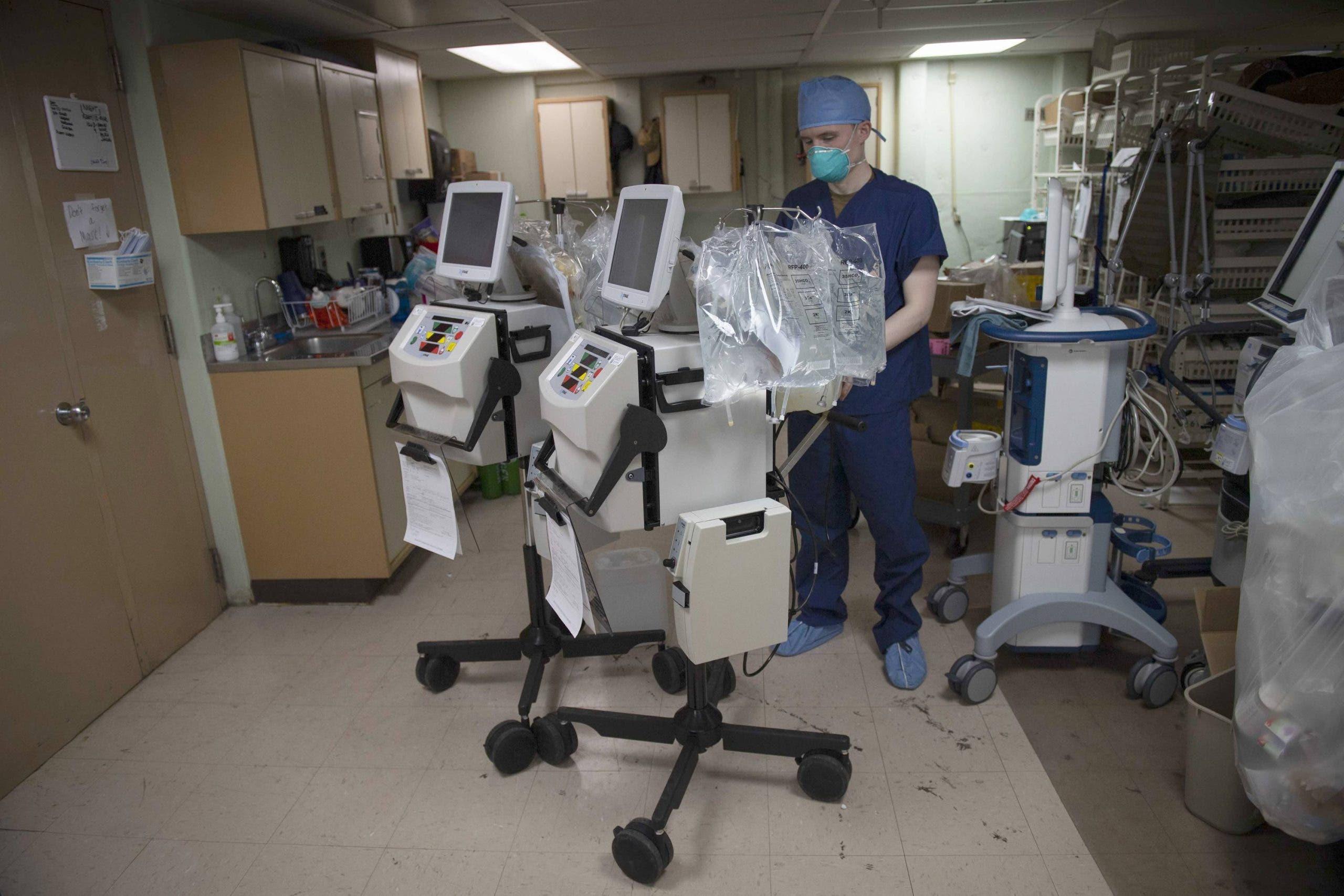 A doctor preparing a dialysis machine