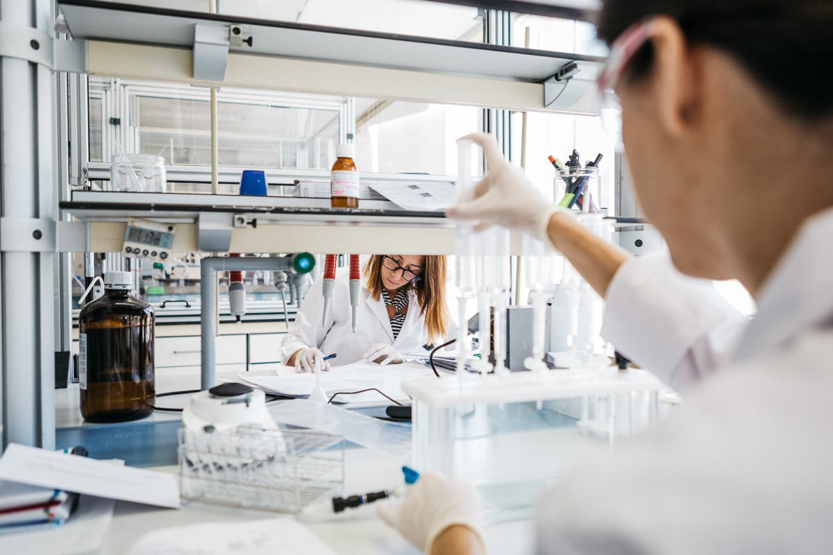 Scientists working at an Ainia laboratory