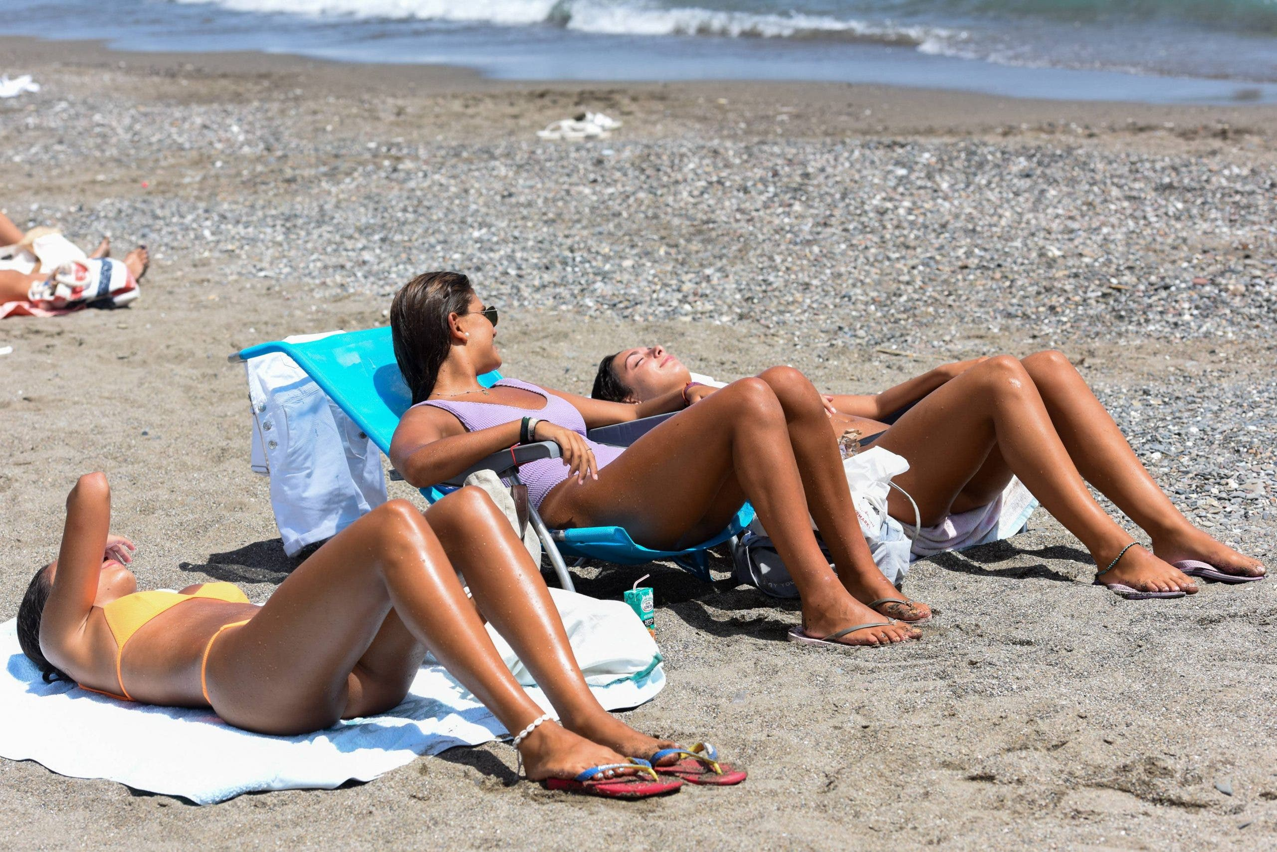MASKED BACKLASH as Spain's Health Minister is forced to reconsider beach mask plans