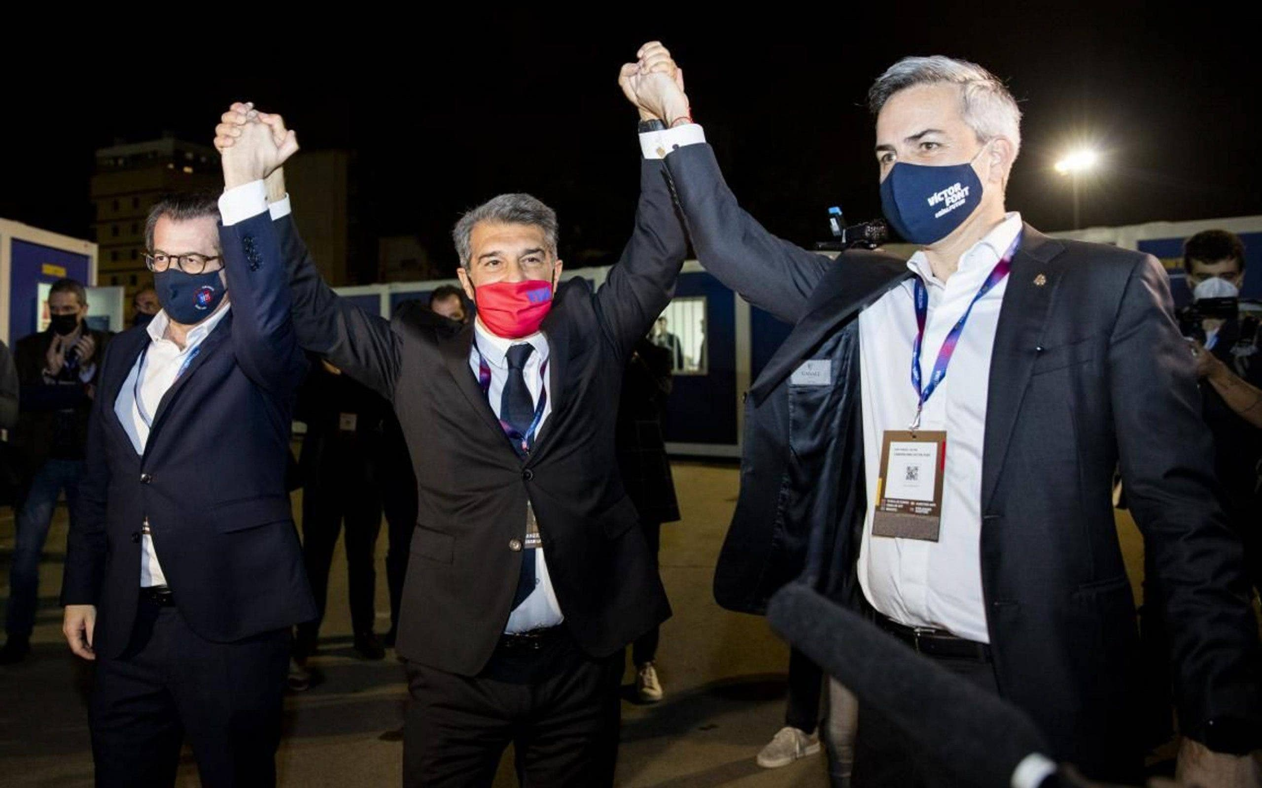 Joan Laporta (centre) with rival candidates Toni Freixa (left) and Victor Font