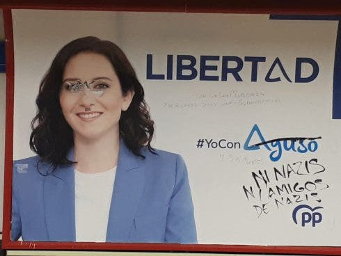 Ayuso election poster vandalised on the Madrid metro