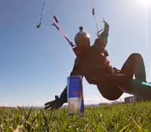 Watch as daredevil skydiver from Spain snaps up can while skimming ground at 60mph