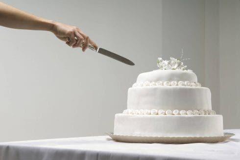 Woman Cutting Wedding Cake